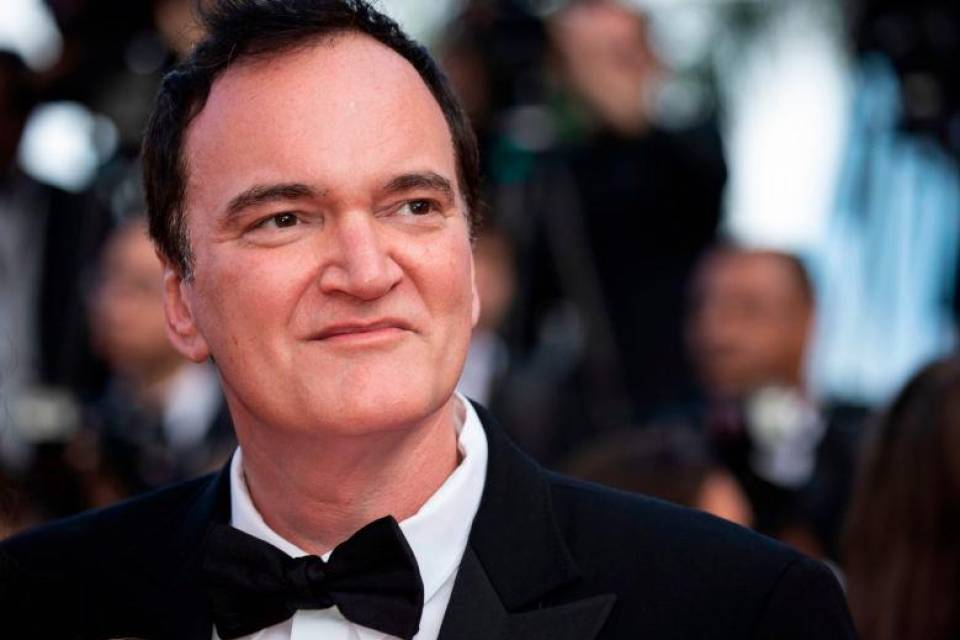 Quentin Tarantino in smoking a Cannes